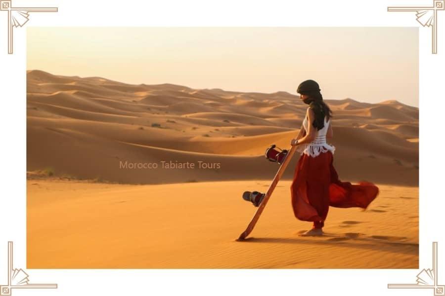Sand boarding in Moroccan Sahara Desert